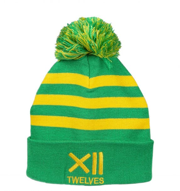 A soft green woolen hat with yellow stripes and a multicoloured yellow and green bobble on top. The Twelves name and logo is displayed on the front in yellow writing