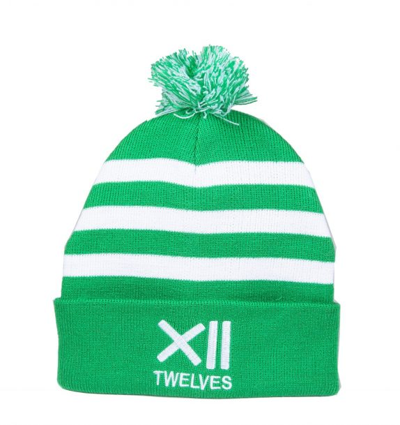 A soft green woollen hat with white stripes and a multicoloured white and green bobble on top. The Twelves name and logo is displayed on the front in white writing